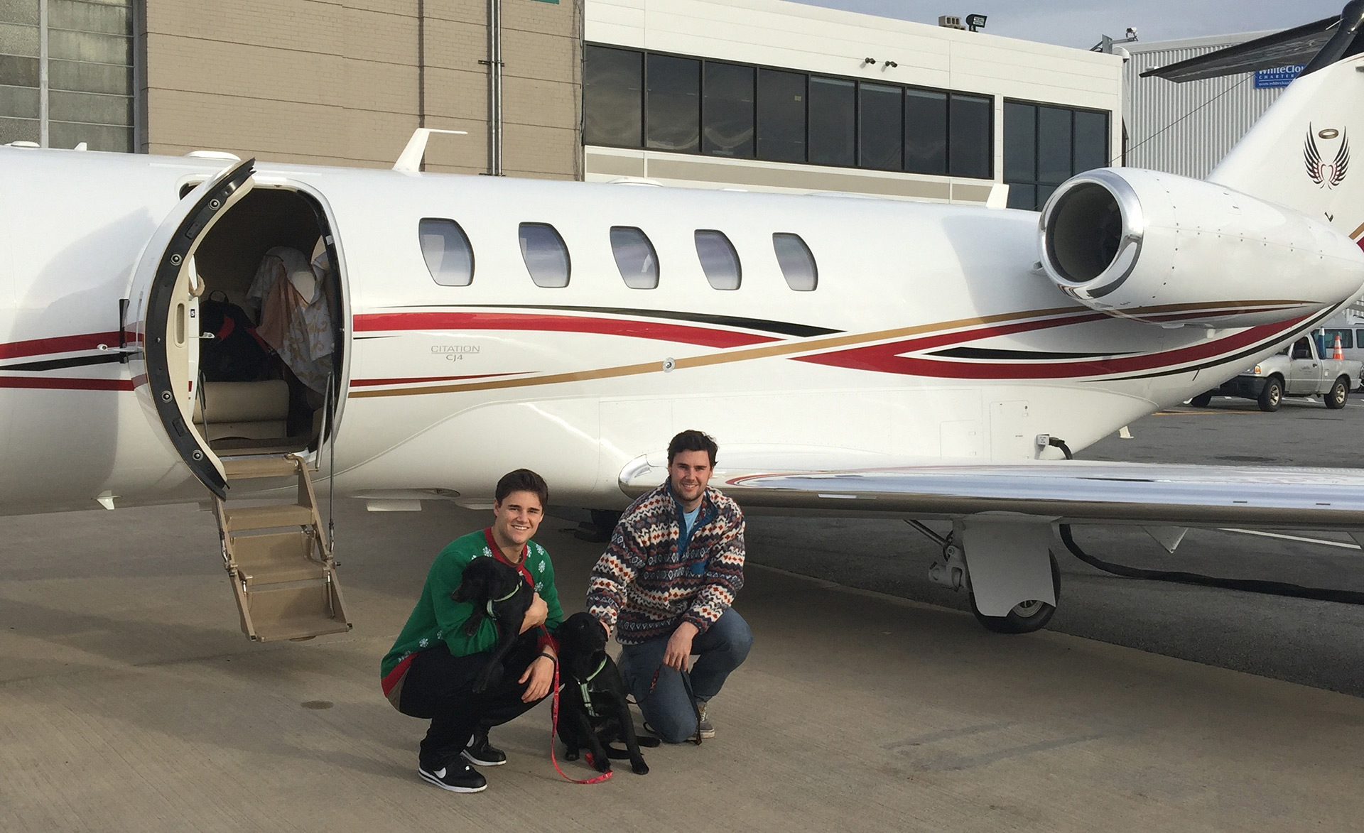 Pilots with pets in front of Cessna Citation